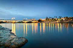 Triana Bridge in the evening light, Sevilla Spain. The Triana bridge over Guadalquivir river, in the evening light in Sevilla, Spain Royalty Free Stock Photos