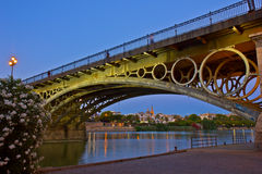 Triana Bridge at night, Seville, Spain Stock Images