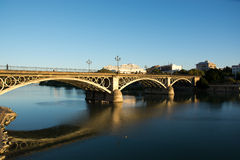 The beautiful bridge of Isabella Cattolica, on the Guadalquivir River in Seville, also known as the Triana Bridge. Triana bridge in the typical neighborhood in royalty free stock photo