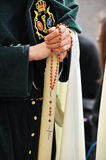 Triana nazarene, woman with rosary in her hands, brotherhood of Hope, Holy Week in Seville, Andalusia, Spain Royalty Free Stock Photos