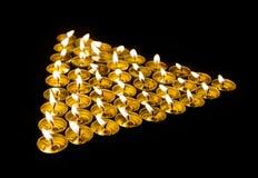 Triangel som göras av stearinljus Royaltyfria Bilder