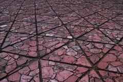 Triangelform av jordkvarteret har textur av den plana stenen Royaltyfri Fotografi