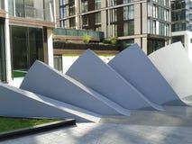 Trianglar i rad Arkivfoto