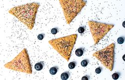 Triangle biscuits with blueberry fruit. Triangle integral biscuits with blueberry fruit Royalty Free Stock Photography