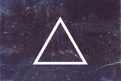 Triangle blanche sur le fond foncé Photo libre de droits