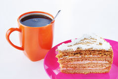Triangle cake with cup of hot coffee Royalty Free Stock Photos