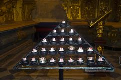 Triangle chandelier with candles in the church stock photo