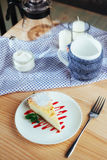 Triangle cheese cakes in cafe. On a wooden table Stock Photo