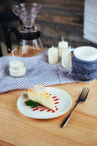 Triangle cheese cakes in cafe. On a wooden table Stock Photography