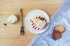 Triangle cheese cakes in cafe. On a wooden table Royalty Free Stock Photography