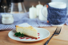 Triangle cheese cakes in cafe. On a wooden table Royalty Free Stock Images