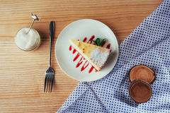 Triangle cheese cakes in cafe. On a wooden table Royalty Free Stock Photo