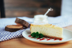 Triangle cheese cakes in cafe. On a wooden table Stock Images