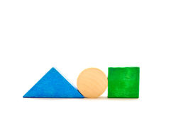Triangle, circle and square with wooden blocks Stock Images
