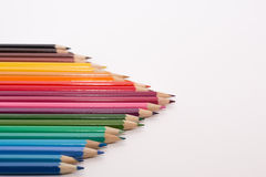 Triangle of colored pencils Royalty Free Stock Photo
