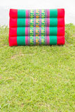 Triangle Colorful Pillows On The Grass. Royalty Free Stock Photography