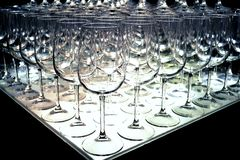 Triangle of empty wine glasses rows for tasting arranged at a wine show. royalty free stock photo