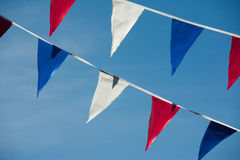 Triangle flags. Against a blue sky background Stock Photo