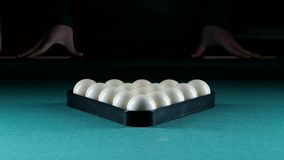 Triangle forms a pyramid of billiard balls. On a green table stock video footage