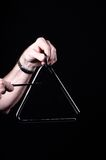 Triangle Isolated on black Stock Photos