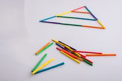 A triangle made of colorful sticks royalty free stock photo