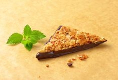 Triangle nut bar dipped in chocolate Royalty Free Stock Photos