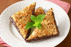 Triangle nut bars dipped in chocolate Stock Image