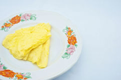 Triangle omelette on plate. Omelette made a triangle placed on the plate with white background Royalty Free Stock Image