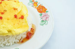 Triangle omelette on rice with  chill sauce. Omelette made a triangle put on rice placed on the plate with white background Royalty Free Stock Image