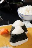 Triangle onigiri. On the table Stock Image