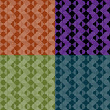 Triangle patterns. Abstract geometric seamless patterns four colorways Royalty Free Stock Images