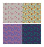 Triangle patterns in retro nostalgic colors. Set of seamless patterns in 70s or 80s style. Triangle patterns in retro nostalgic colors. Set of seamless patterns Royalty Free Stock Photos