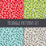 Triangle patterns set. Red, blue, green, grey, brown vector seamless geometric backgrounds. Triangle patterns set. Vector seamless triangular backgrounds Stock Photography