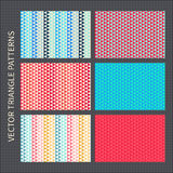 Triangle patterns set. Red, pink, blue, yellow vector seamless backgrounds Royalty Free Stock Photos