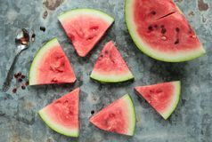 Triangle pieces of watermelon. Pieces of watermelon on a  metal board Stock Photography