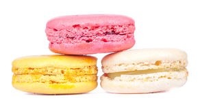 Triangle pile of color ful french macaroons dessert on white bak Royalty Free Stock Photos