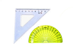 Triangle and protractor. Under the white background stock images
