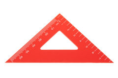Triangle protractor closeup. Red triangle protractor closeup. On a white background royalty free stock image