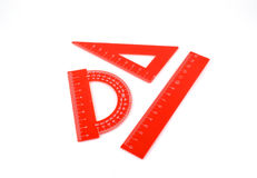 Triangle, protractor and ruler Stock Images