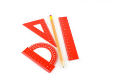 Triangle, protractor, ruler and pencil Royalty Free Stock Photography