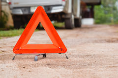 Triangle Red emergency stop sign, broken, damaged cars parked on the street Royalty Free Stock Photo