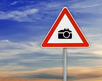 Triangle on rod road sign camera attention with cloudy sky. Natural sky blur background royalty free stock photography