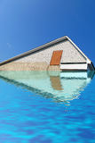 Triangle roof from white brick under water, sky, Stock Photo