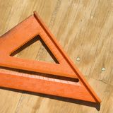 Triangle ruler. Triangle ruler on unfinished wood Stock Photo