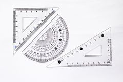 Triangle ruler and protractor set. Triangle ruler and protractor over white background. Mathematics graphics learning tools necessary royalty free stock images