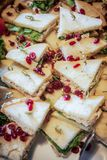 Triangle sandwich appetizer covered in cranberries Stock Photo