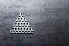 Triangle from nuts on metal background Royalty Free Stock Image