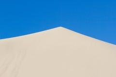 Triangle shape background. Sand pyramid wallpaper landscape. Sky Stock Photography