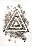 Triangle shape symbol drawing in dust as order in chaos Royalty Free Stock Photos