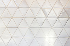 Triangle shaped ceramic tiles wall background Royalty Free Stock Images